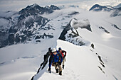 Climbers (l-r) Jim Prager and Obadiah Reid climb the NE Arete of Wedge Mountain in Garibaldi Provincial Park, British Columbia, Canada on June 14, 2009.