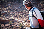 Riders descend into the canyon on  mountain bikes while touring the White Rim Trail near Moab, Utah.