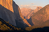 Golden evening sunshine illuminates El Capitan and Half Dome in Yosemite Valley, Yosemite National Park, UNESCO World Heritage Site, California, United States of America, North America