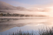 Misty morning over Loweswater in autumn in the Lake District National Park, Cumbria, England, United Kingdom, Europe