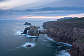 Sunset over the dramatic cliffs of Land's End, Cornwall, England, United Kingdom, Europe