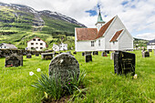 Cemetery in front of church in the town of Olden, Briksdalen, Nordfjord, Norway, Scandinavia, Europe