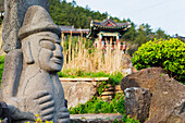 Dol hareubang (harubang) protection and fertility statue at Sanbanggulsa Temple, Jeju Island, South Korea, Asia