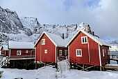 Fresh snow covering the typical Norwegian homes, the Rorbu, in the Lofoten Islands, Arctic, Norway, Scandinavia, Europe