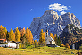 The tiny Church of Selva di Cadore, in the Dolomites, in autumn with the majestic Monte Pelmo in the background, Veneto, Italy, Europe