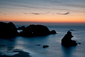 Sunset over unusual rock formations in Porthcothan Bay, Cornwall, England, United Kingdom, Europe
