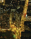 The Flat Iron Building and Broadway illuminated at night, viewed from the Empire State Building, Manhattan, New York City, United States of America, North America
