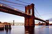 The Brooklyn Bridge spanning the East River between Brooklyn and Manhanttan, New York City, New York, United States of America, North America