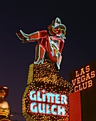 Close-up of neon sign of a cowgirl advertising Glitter Gulch at night in Las Vegas, Nevada, United States of America, North America