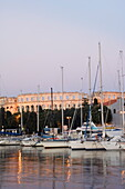 Evening light on harbour yachts, and 1st century Roman amphitheatre, Pula, Istria Coast, Croatia, Europe