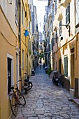 A narrow alley in Corfu Old Town, Corfu, Ionian Islands, Greek Islands, Greece, Europe