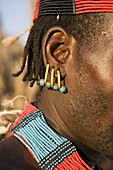 Close-up of earrings worn by a member of the Hamer Tribe, Lower Omo Valley, Ethiopia, Africa