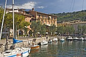 The harbour and waterside cafe, Torre del Benaco, Lake Garda, Veneto, Italy, Europe