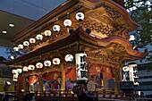 Ornate wooden floats with musicians performing during the Gotenyatai Hikimawashi Festival in Hamamatsu, Shizuoka, Japan, Asia