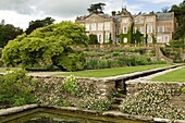 Hestercombe Garden, a terraced garden featuring stone canals leading to stone ponds, with a large acer tree and house beyond, designed by Gertrude Jekyll and Edwin Lutyens, Taunton, Somerset, England, United Kingdom, Europe