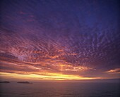 Colourful skies at dusk, over seascape, New Zealand, Pacific
