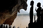 The Pak Ou caves, a well known Buddhist site and place of pilgrimage, 25km from Luang Prabang, Laos, Indochina, Southeast Asia, Asia