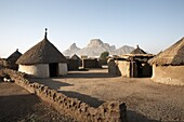 Homes lie in the shadow of Taka Mountain in the town of Kassala, Sudan, Africa
