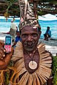 Tribesman holds mobile phone, Nendo Island, Santa Cruz Islands, Solomon Islands, South Pacific
