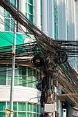 Telephone wires on a mast, Phnom Penh, Phnom Penh, Cambodia, Asia