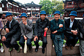 Group of five men with blue hats in Old Town (Nanshi), Shanghai, Shanghai, Asia
