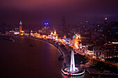 Overhead of the Bund along Huangpu River with with People's Heroes Memorial at night, Shanghai, Shanghai, Asia