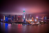 Huangpu River with Oriental Pearl Tower and Pudong skyline at night, Shanghai, Shanghai, Asia