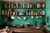 Historic cans and kitchen utensils on display at the museum of Port Lockroy British Antarctic Survey Station, Port Lockroy, Wiencke Island, Antarctica