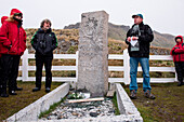 'Visitors from cruise ships traditionally hold a ceremony and a toast at the grave of famed explorer Sir Ernest Shackleton; here (on the right) Captain Thilo Natke of expedition cruise ship MS Hanseatic (Hapag-Lloyd Cruises) with (on the left) famous moun