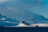 Majestic panorama of snow-covered mountains and ice, Half Moon Island, South Shetland Islands, Antarctica