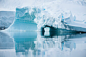 Chunks of ice, icebergs and entire landscapes reflected in the still and moving waters of Paradise Bay make for stunning images and interesting works of abstract art, Paradise Bay (Paradise Harbor), Danco Coast, Graham Land, Antarctica