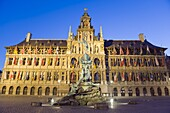 Baroque Brabo fountain, built in 1887, by Jef Lambeaux, Stadhuis (city hall) illuminated at night, Antwerp, Flanders, Belgium, Europe