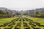The greenery of the Parque Eduard VII runs towards the Marques de Pombal memorial in central Lisbon, Portugal, Europe