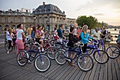 Visitors touring the city by bicycle, Paris, France, Europe