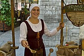 Traditionally dressed girl selling stuff from the Middle Ages, Tallinn, Estonia, Baltic States, Europe