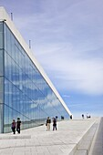Visitors walking outside the Oslo Opera house exterior in summer sunshine, city centre, Oslo, Norway, Scandinavia, Europe