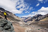 Hiker looking down to base camp, Plaza de Mulas, Aconcagua Provincial Park, Andes mountains, Argentina, South America