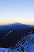 Full moon at sunrise and shadow of Aconcagua 6962m, highest peak in South America, Aconcagua Provincial Park, Andes mountains, Argentina, South America