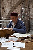Ancient style of writing during an historical reenactment at Venice Arsenale, Venice, Veneto, Italy, Europe