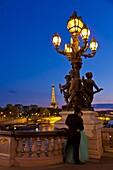 Eiffel Tower seen from the Pont Alexandre III (Alexander III Bridge) at night, Paris, France, Europe
