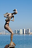 Mermaid Angel Playing Saxophone sculpture on the Malecon, Puerto Vallarta, Jalisco, Mexico, North America