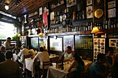 People sitting at Adega do Pimenta restaurant in Santa Teresa neighbourhood, Rio de Janeiro, Brazil, South America
