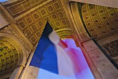 French flag flying at dusk, Arc de Triomphe, Paris, France, Europe