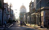 View along street towards Parque Jose Marti, Cienfuegos, Cuba, West Indies, Central America