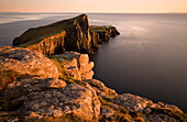 Neist Point and Lighthouse bathed in evening light, Isle of Skye, Highland, Scotland, United Kingdom, Europe