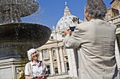 Senior tourists sightseeing in St. Peters Square, Rome, Lazio, Italy, Europe