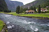 Flam church dating from 1670, and Flamsdalen Valley River, Flam, Sognefjorden, Western Fjords, Norway, Scandinavia, Europe