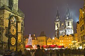 Old Town Hall, Astronomical clock, Tyn Cathedral and Old Town Square at Christmas time, Prague, Czech Republic, Europe