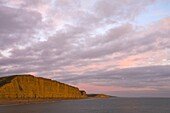 Towering sandstone cliffs at West Bay on the Jurassic Coast, UNESCO World Heritage Site, Dorset,  England, United Kingdom, Europe