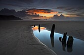 Beachside at Rhossili Bay, with the wreck of the Helvetia buried in the sand and Worm's Head on the horizon, Rhossili Bay, Gower, Wales, United Kingdom, Europe